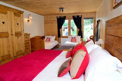 Chalet Cannelle Owl Bedroom - double superking bed  or family suite with 2 extra single beds - bath/shower ensuite - garden view