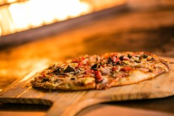 Delectable pizza fresh from our the wooden fire grill