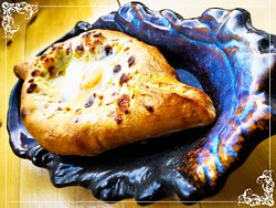 'Adjarian Khachapuri' ( cheese , egg & butter )