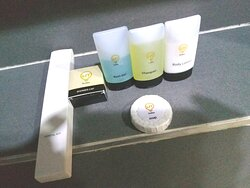 Lit Suites Complimentary Dental Kit, Shower Cap, Bath Gel, Shampoo, Body Lotion and Soap.
