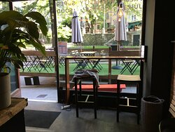 High stools with view to the sidewalk deck