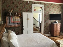 The Huge Bedroom with 14 foot high ceilings, big bathroom with jetted tub and a snack fridge!