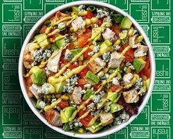 Cobb Salad Grilled Chicken, Avocado, Bleu Cheese, Tomatoes, Corn, Freshii Mix 'n Romaine served with Honey Dijon Dressing.