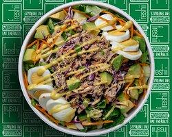 Kona Salad Romaine, Gourmet Tuna, Carrots, Cabbage, Green Onion, Avocado, Egg Slice, Celery, Greek Yogurt dressed with Honey Dijon Dressing.