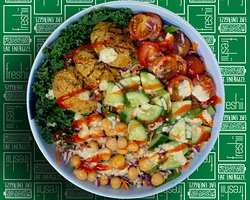 Falafel Bowl Brown rice, kale, falafel, cucumber, cherry tomato, chickpeas, beet - carrot - cabbage slaw, dressed with tahini, cucumber dill & sriracha