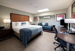 Our simple and elegant Single King Room is perfect for the business or leisure traveler. Get a good night's sleep in a King-sized bed with plush pillows and fresh linens. Wake up each morning to brew a cup of coffee with your in-room coffee maker. A microwave and refrigerator are also included.