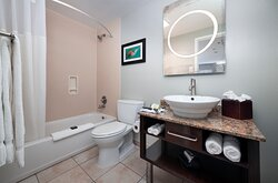 A cozy bathrobe is waiting for you in your bathroom, equipped with PH bath products, fresh towels, and a hairdryer.