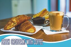 Delicious fresh Croissants with Latte, Capuccino or Tea