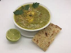 Eshkeneh: Turmeric and fenugreek soup with an organic poached egg, served with persian bread and lime.