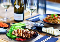 Crispy Peking duck with a chilled bottle of local wine