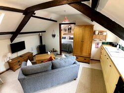 Red Kite Cottage - Open plan living room with wood-burning stove. Smart TV with Freeview and apps including Netflix, Amazon Prime, YouTube and BBC iPlayer. Free high-speed fibre broadband.