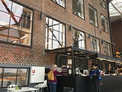 The former shipyard and factorybuildings are at the core of the building with modern day architecture adding a cool touch. The cafe serves light meals and good coffee.