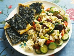 Some pieces of diamesa (traditional Pontians' recipe) and freshly cut Greek salad.