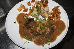 beef steak with mushroom sauce and vegetable.