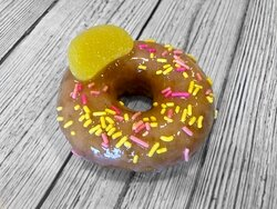 Pink Lemonade: Vanilla donut homemade pink lemonade glaze sprinkles lemon gum drop!