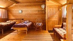 Bedroom. Red/brown color textiles. Makuuhuone. Puna-ruskeat tekstiilit.