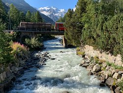"Classic artistic photos by me- the bright red carriages of the Bernina Express, the snow capped Swiss Alps and the ice cold crystal clear and pure bubbling water of the rushing mountain stream. Please let me know if you find these photos ""helpful."""
