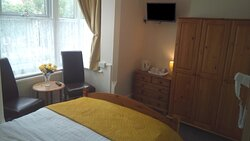 Room 5 - Deluxe Double fully en-suite room with bay window seating area.