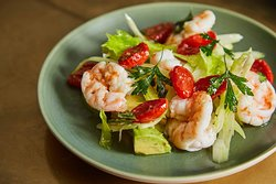 Steamed tiger prawns with confit cherry tomatoes, celery and avocado