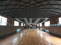 Inside the historic gym.  Look how the ceiling/roof is built!