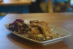 Daily Special Char grilled Chicken Breast on Home-made Humus placed on toasted artisan bread with salad