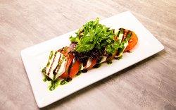 Caprese Salad , Balsamic glaze, ripe tomatoes, fresh Mozzarella cheese, pesto sauce !!!