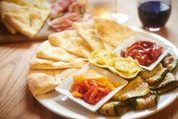 Vegetable sharing board with rosemary focaccia