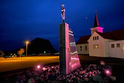 Statue in October illuminated in pink (breast cancer awareness month)
