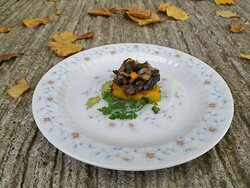 Wild mushrooms on a roasted pumpkin with rosemary