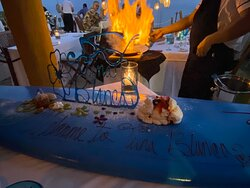 Surfboard of deserts with the neighbor's raicilla temazcal shrimp in the background.