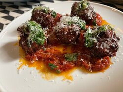 Our homemade meatballs with tomato sauce & salsa verde to finish.