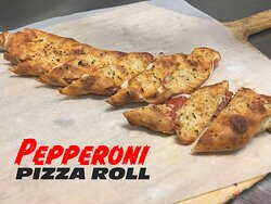 Pepperoni Pizza Roll  Pepperoni & mozzarella cheese rolled inside of freshly prepared dough, brushed with garlic butter & topped with seasoning then baked to perfection!