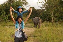Posing with a rhino in Ziwa Rhino Sanctuary.