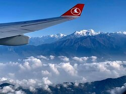 A view of Himalayas while flying to Nepal. Photo: Olga