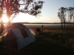 Bush camping overlooking the lake, native miner birds and galahs in the trees, magpies singing in the morning