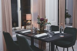 Dining table in one of rooms at Embassy