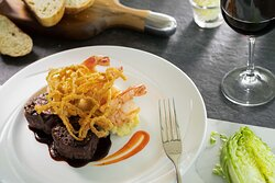 One of our Ruthie's Siganture dishes is the Filet Medallions & Shrimp. This dish features filet medallions with a pink peppercorn crust, garlic-herb shrimp, garlic confit yukon mash, cabernet demi glace, and crispy onion strings.