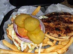 Jerk chicken sandwich and fries
