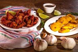 Carne de Cerdo Frita con tostones •Fried Pork with Tostones
