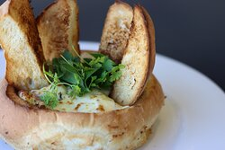 Stuffed Cobb Loaf  Cobb loaf filled with creamed cheese, bacon, onion, garlic and chives.