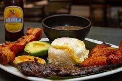 Bandeja Paisa Kidney beans, pork belly chicharron, Colombian sausage , sweet plantain, fried egg, avocado, rice & churrasco .