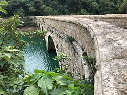 A historic masonry bridge crossing one of the reservoirs lower in the valley