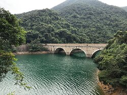 Historic masonry bridge crossing the reservoir in Tai Tam Country Park
