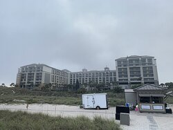 View of hotel from the beach.  The entire left side is under renovation.