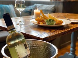 Lightly Ale battered cod served with rustic chips, peas, home made tartare sauce and a lemon wedge