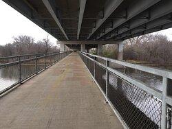 Trail bridge underneath highway bridge