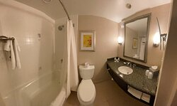 Bathroom with shower/tub and a single sink