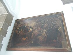 """One of the big paintings on a wall (apart from those along the two sides of the """"main aisle"""")"""