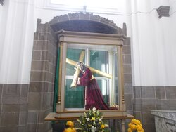 """The shrine featuring Christ carrying the Cross (with also like a """"praying area"""" in front)"""