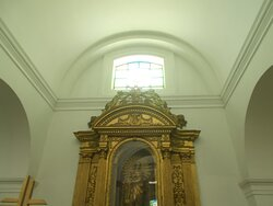 The shrine likely featuring the Virgin holding a child (on one side along the length of the Cathedral)